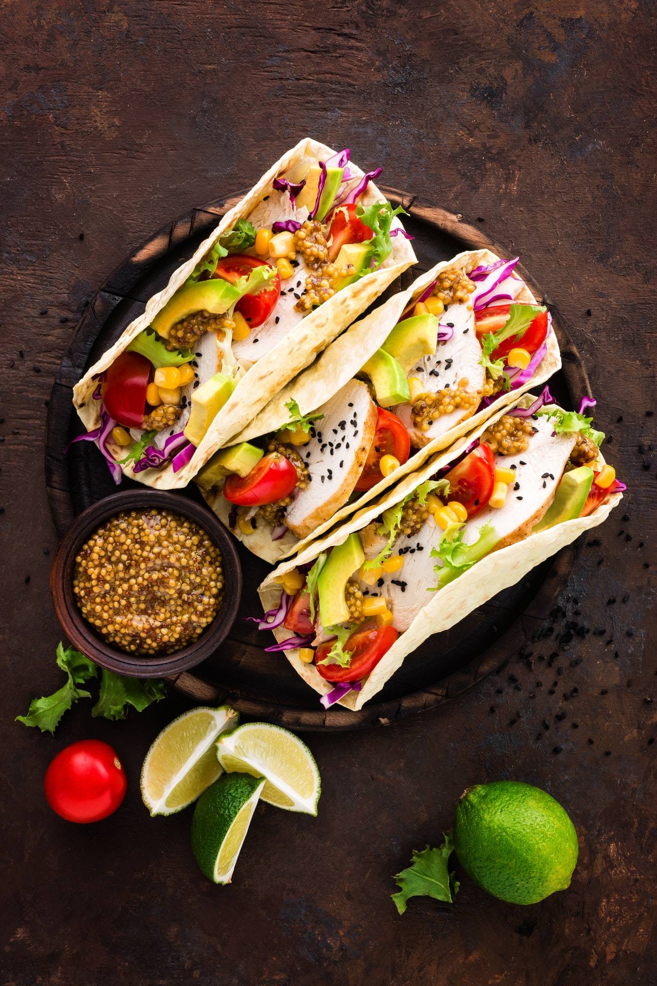 Mexican tacos with chicken meat, vegetables and fresh greens